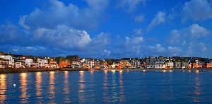 sunrise-over-the-celtic-sea-at-st-ives-view-of-houses-lining-the-coastline-c-visitengland-andrew-boxall