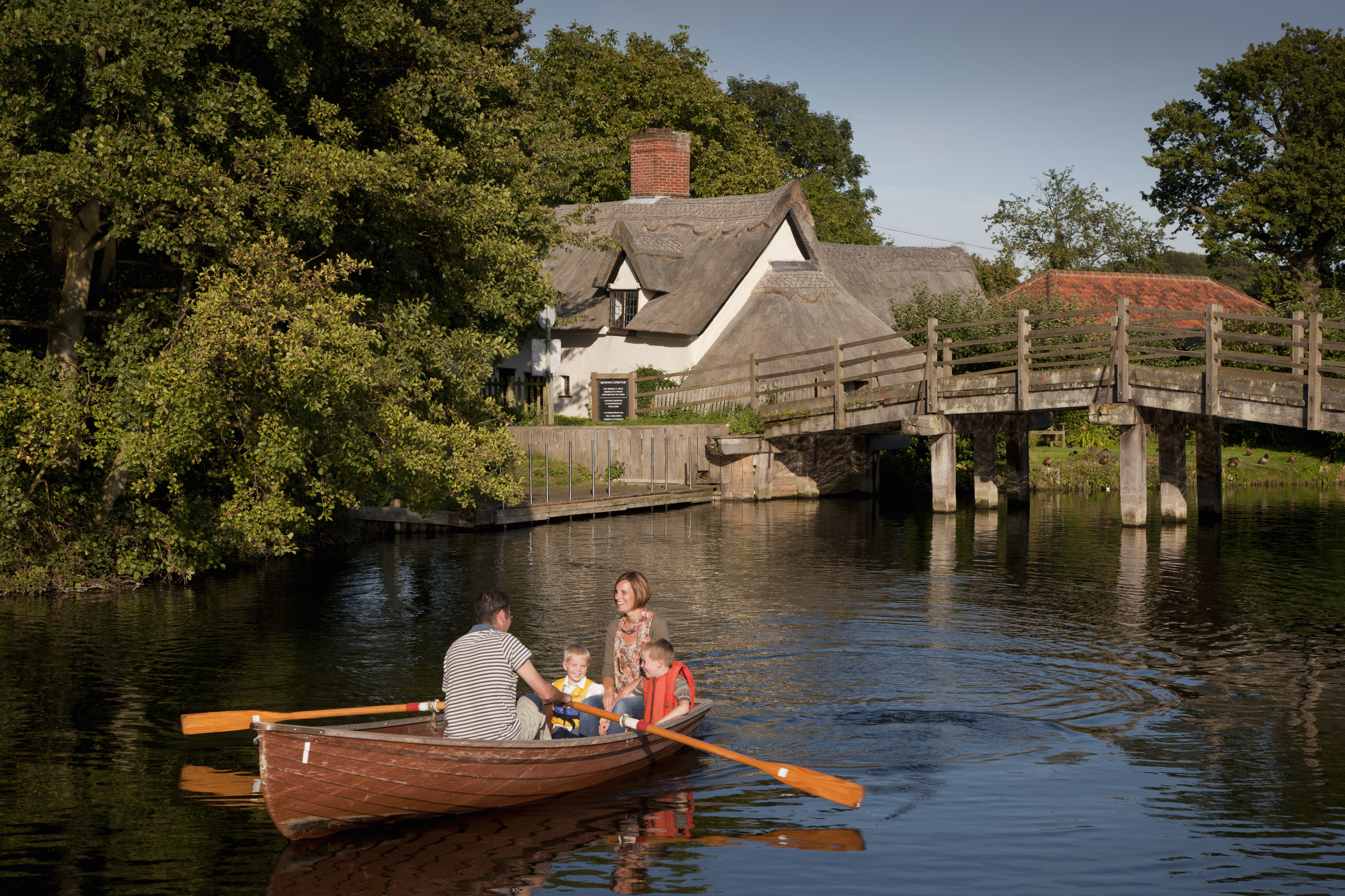 Family in a rowing boat at Flatford Mill on the River Stour in East Bergholt, Suffolk  Additional Credit: Choose Suffolk